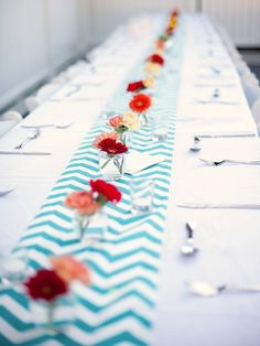 white table cloths with a patterned table runner