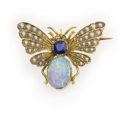 An opal, sapphire and half-pearl butterfly brooch, the abdomen set with an oval opal, estimated to weigh 1.3 carats, the thorax with a cushion-cut sapphire, weighing approximately 0.5 carats, the wings set with half pearls, all set in yellow gold, gross weight 5.8 grams, circa 1880.