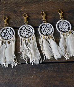 Our dream catcher charms in white are too cute! Use them as a key chain… handmade kniting jewelry, bag decor and boho flowGorgeous Artisan Crafted Keychains by Guatemala Womens Global Creative Co-op. Each keychain is unique. These sell out often so Dream Catcher White, Dream Catcher Boho, Dream Catcher Wedding, Lace Dream Catchers, Dream Catcher Earrings, Dream Wedding, Diy Tumblr, Crochet Dreamcatcher, Dreamcatcher Keychain