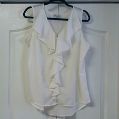 Ruffled dress top Pretty dressy top by Kim Rogers. Can dress up for work or down for casual. 97% polyester. Couple of very small spots shown in last couple of photos. Otherwise in great condition! I ❤️ OFFERS! TOP-RATED FAST SHIPPER USE BUNDLE FOR SAVINGS Kim Rogers Tops Blouses