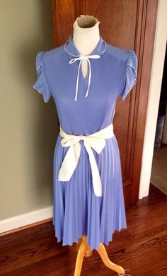 A personal favorite from my Etsy shop https://www.etsy.com/listing/280204002/sweet-vintage-dress-in-country-blue-with
