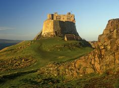 Lindisfarne Castle, a 16th-century castle located on Holy Island, near Berwick-upon-Tweed, Northumberland, England, much altered by Sir Edwin Lutyens in 1901. The island is accessible from the mainland at low tide by means of a causeway.