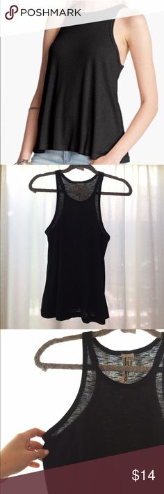 Free People Long Beach Tank Black high neck 'Long Beach' tank from FP. Super popular tank for good reason. Very flattering and cute. Free People Tops Tank Tops