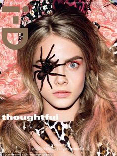 Fearless Cara Delevingne can be seen posing with a tarantula on her eye in this month's i-D magazine