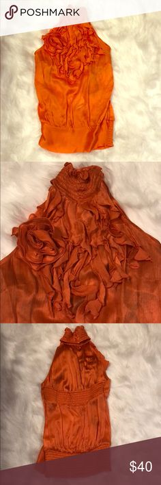 NWT Bebe Orange Silk Sleeveless Ruffle Trim Top Super cute and sexy Bebe Top!  NWT, never worn.  It is backless on the upper back.  Halter top style.  Perfect for Spring/Summer wear! bebe Tops Blouses