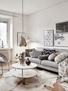 77 Gorgeous Examples of Scandinavian Interior Design. 77 Gorgeous Examples of Scandinavian Interior Design Neutral-Nordic-living-room-with-copper-light-feature. Nordic Living Room, My Living Room, Home And Living, Living Room Decor, Scandinavian Living, Modern Living, Scandinavian Christmas, Living Room Neutral, Cow Hide Rug Living Room