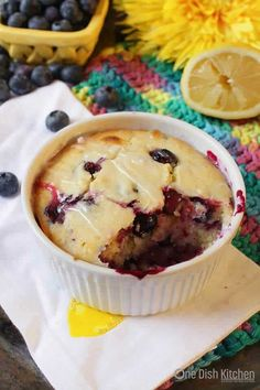 Big bakery style Lemon Blueberry Muffin For One. A single muffin loaded with plump, sweet blueberries and tart lemon juice. Baked in a ramekin, this perfectly sweet muffin is topped with a sweet and tangy lemon glaze. Perfect for breakfast, a snack or dessert.   One Dish Kitchen