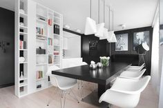 M68 by Widawscy Studio Architektury. White and black dining room.