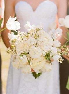 The bride's bouquet recipe: white tulips, white lilac, David Austin garden roses, ranunculus, white sweet peas, and fringed tulips. Photo by Raya Photography