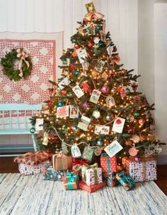 """Overflowing with good tidings, this """"friends and family"""" tree features an assortment of holiday gree... - Monica Buck"""