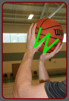 "Basketball Shooting Tips - Hand Placement | Your hands should form a ""W"" with your thumbs almost touching. Your dominant hand needs to be behind the ball: a good frame of reference is to line your dominant hand so that the hole for the inflation needle is between your middle and pointer finger. Your ""off"" hand or non-dominant (most peoples left hand) should be placed on the side of the basketball and is your ""guide hand""."