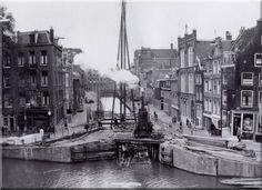 """1951. Maintenance work on the bridge across the Passeerdersgracht in Amsterdam. The Passeerdersgracht is a small canal connecting the Prinsengracht and Lijnbaansgracht. The canal arose when in 1612 the canal belt was dug. The gracht was named after a """"Passeerderij"""" which was an old name for a shop where (Spanish) leather was manufactured. Today most canal houses at the Passeerdersgracht have been converted into residential homes. #amsterdam #1951 #Passeerdersgracht #Jordaan"""
