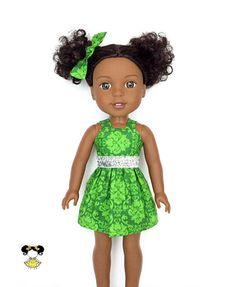 Cute and festive in this mini spaghetti strap party doll dress, perfect for Wellie Wishers! The dress features a green Christmas damask print with spaghetti straps and a Velcro closure. A matching hairbow completed the look. Item was handcrafted in our pet free, smoke free sewing studio.