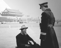 A peaceful old man practicing Falun Gong and a police officer