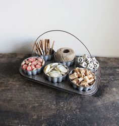 DIY Upcycled Vintage Muffin Pan & Jello Molds - turn an old baking tin and shaped Jell-o molds from the flea market into a craft caddy or office organizer. So shabby chic!