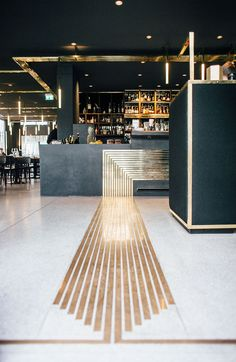Herzog Bar & Restaurant in Munich with brass veins in the flooring. Photo © BUILD Inc.