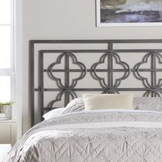 An open quatrefoil motif gives this metal headboard a dash of drama while its metallic finish adds glam style to any space. Use it to anchor a bold boho guest room ensemble then pair it with crisp white bedding for a resort-worthy look.