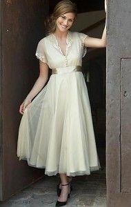 Elegant vintage wedding dress. Love the softness and simplicity.