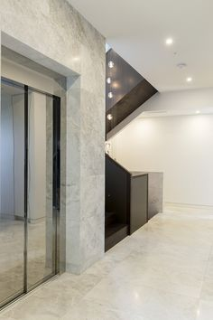 Stairs | Staircase | Architecture | Interior Design | Feature Wall | Aluminium Balustrade Panels | Timber Handrail | Timber Treads | American Oak | Stairwell Lighting | Modern | Feature