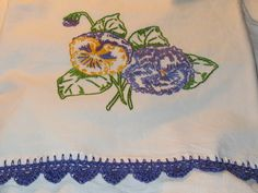 Pansies on a flour sack dish towel with crochet trim
