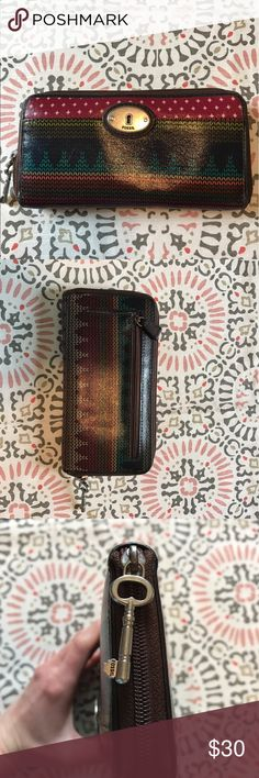 Fossil Wallet Gorgeous Fossil wallet. Multicolored with key zipper. Outside pocket as well as inside card holders and inside zip for coins. This wallet is the perfect accessory to brighten up your day! Light wear. Bags Wallets