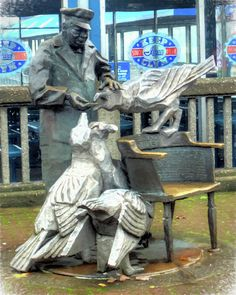 """This Fine Art Print is titled; """"Mayor of the Waterfront"""". This image features a statue to Ivar Haglund, the """"Mayor of the Waterfront"""" and founder of Ivar's Acres of Clams Seafood Restaurant in Seattle, Washington. He enjoyed feeding seagulls French fries outside of his restaurant on the Seattle, Washington, waterfront. He coined the saying; """"Keep Clam.""""   This Fine Art Print would look great if displayed in a library, waiting room, restaurant, lobby, waiting area, antique store, seafood…"""