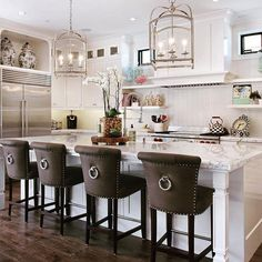 Classic barstools enhance this traditional kitchen - 18 Stylish Bar Stools for Your Kitchen