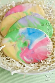 Tie Dye Easter Egg Sugar Cookies~T~ I love this idea, it is so fun for kids. She gives one of the best tips that I have ever read about rolling sugar cookies. Use powered sugar instead of flour on your rolling surface to give a nice sugar flavor.