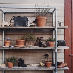 pipe shelving unit made with #KeeKlamp pipe fittings