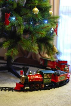We used to have a toy train with lights and whistle...would put it around the tree every year. Think I gave it to someone else to enjoy!