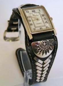 Exquisite Native American Indian Navajo hand tooled Black Leather and Sterling Silver Men's Jewelry Watch. I cannot say enough about the WOW factor in this beautiful watch