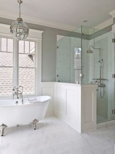 clawfoot tub bathroom ideas with half walls