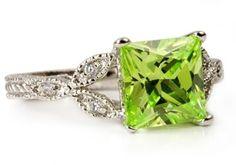 Beautiful peridot wedding ring, I would like blue topaz better