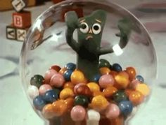gumby gumball machine  trapped in a glass case of emotion