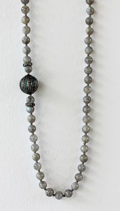 Emerald Bead on Knotted Labradorite $2500