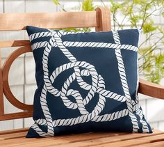 Love this nautical rope pillow.  Pottery Barn.
