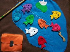 Would make a really fun quiet busy book page. Fishing with magnets. I would add numbers too for more of a challenge and have kiddo put numbers in order which might just turn out to be the rainbow order. :)