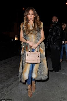 Thinking pink: The star carried a pastel and gold handbag and accessorised with oversized ...