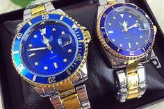 OFERTA SOC! Doar 119 RON Set 2 ceasuri el si ea din metal argintiu si auriu cu cadran albastru + CUTIE CADOU