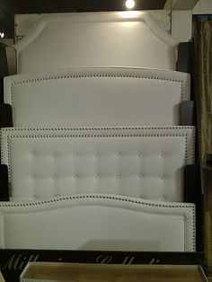 Nail heads are great on headboards. Like the two curved ones but with double row of nail heads perhaps.