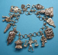Vintage Sterling Silver Asian Charm Bracelet - Eight Rare Charms from just4girls on Ruby Lane