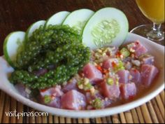 Kinilaw or Fish Salad is a one of the popular dish in the philippines its used as a appetizer accompanied by beer but most of the time it is eaten as a meal itself...this food is made from fresh raw fish in any kind but most the time pilipino used tuna fish for it then flavored by vinegar,salt.inions,ginger and dashi to taste, some part of the philippines they used lime to enhance the taste and a little amount of mayo to thicken the sauce..you can also add cucumber, green mango or seaweeds…