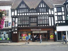 A WH Smith shop front under a black and white painted wattle and daub building, Stratford, England