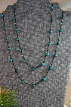 * 46 Inch Crochet Beaded Necklace * Can be worn as a long single strand necklace, or wrapped to be worn as a short double strand necklace * Silk Black Thread * 6 mm Turquoise Colored glass beads * Green Miyuki Seed Beads * Shell Button Closure Crochet Beaded Necklace, Bead Crochet, J Necklace, Necklace Lengths, Bohemian Necklace, Boho Jewelry, Handmade Beaded Jewelry, Blue Bonnets, Wire Wrapped Jewelry