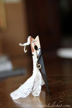 Kissing couples made with clothes pin - Recyclart