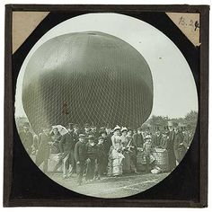 A crowd posed in front of a partially-inflated balloon. Cecil Shadbolt is pictured standing third from the right, wearing a bowler hat. Greater London Authority