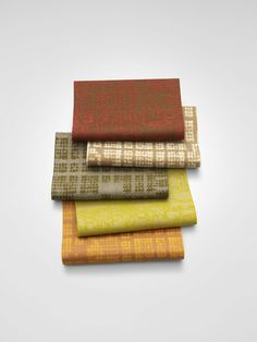 Upholstery fabrics Grid 1+2 are designed by Patricia Urquiola for Kvadrat. The patterns of the textiles are related: Grid 1 is based only on a grid while Grid 2 contains a digital motif inserted within the grid. They comprise different shapes, which are in a contrasting colour to the background. These emerge in an irregular way from the fabric.