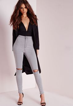 Gettin' skinny with it! Showcase some gorge styling in these ripped light grey skinny jeans. The high waisted design and on trend open rips to the knee means this pair should be on every MG girls wish list. Team up with a white tee, faux le...