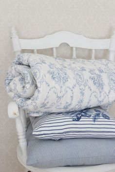 pale blue and white textiles