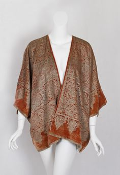 Stenciled velvet jacket (front view) | Mariano Fortuny (Spanish, 1871-1949) | Italy, circa 1930 | The 'lace' pattern shows Fortuny's inspiration often came from several sources. He synthesized ideas to create a new and different design. Here Fortuny combines blocks based on Islamic tiles with borders based on 17th century lace | The pattern is hand stenciled with layers of subtly changing silver/gray pigment, reproducing the Renaissance fresco effect on terra cotta silk velvet